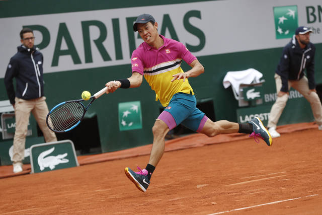 Japan's Kei Nishikori plays a shot against France's Benoit Paire during their fourth round match of the French Open tennis tournament at the Roland Garros stadium in Paris, Monday, June 3, 2019. (AP Photo/Pavel Golovkin)