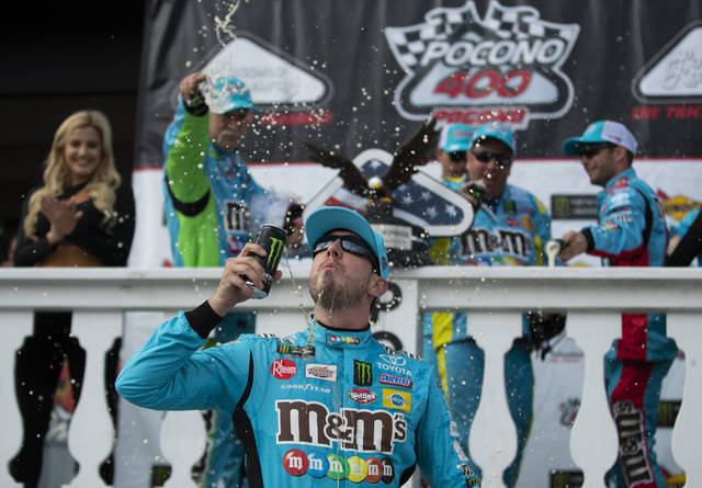 Kyle Busch celebrates in victory lane after winning a NASCAR Cup Series auto race at Pocono Raceway, Sunday, June 2, 2019, in Long Pond, Pa. (AP Photo/Matt Slocum)