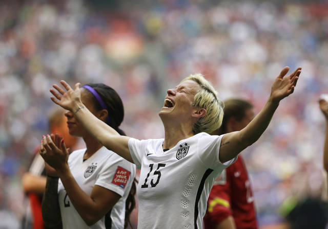 FILE - In this July 5, 2015, file photo, United States' Megan Rapinoe celebrates after the U.S. beat Japan 5-2 in the FIFA Women's World Cup soccer championship in Vancouver, British Columbia. The U.S. national team, ranked No. 1 globally, will try to defend its title in soccer's premier tournament, which kicks off on June 7. (AP Photo/Elaine Thompson, File)