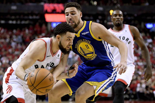 Toronto Raptors guard Fred VanVleet (23) moves the ball around Golden State Warriors guard Klay Thompson (11) during the second half of Game 2 of basketball's NBA Finals, Sunday, June 2, 2019, in Toronto. (Frank Gunn/The Canadian Press via AP)