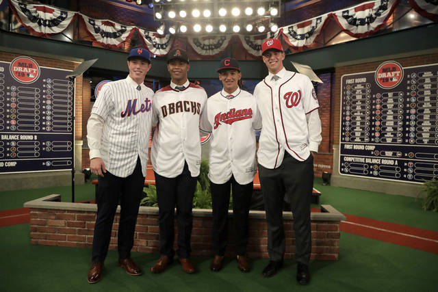 From left to right, prospects Brett Baty, Brennan Malone, Daniel Espino and Jackson Rutledge pose for photos after the first round of the Major League Baseball draft, Monday, June 3, 2019, in Secaucus, N.J. (AP Photo/Julio Cortez)