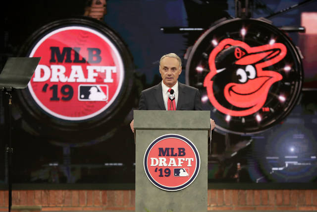 Major League Baseball Commissioner Rob Manfred announces Adley Rutschman, a catcher from Oregon State University, as the No. 1 selection by the Baltimore Orioles in the first round of the Major League Baseball draft, Monday, June 3, 2019, in Secaucus, N.J. (AP Photo/Julio Cortez)