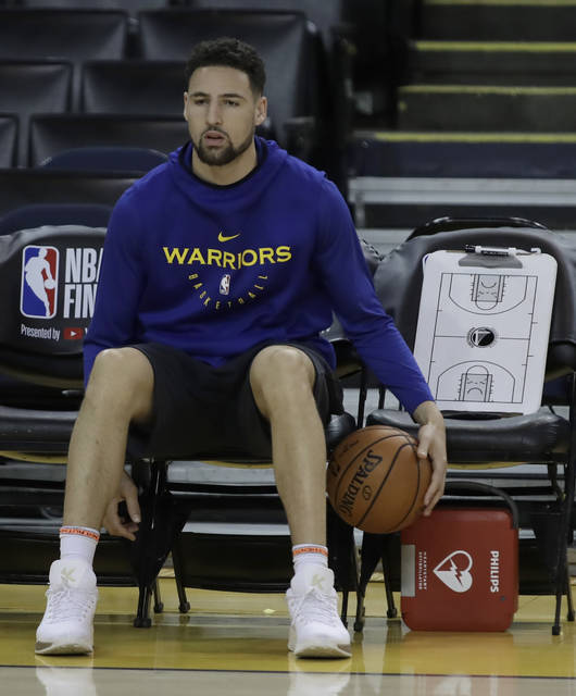 Golden State Warriors' Klay Thompson sits on the bench during practice for the NBA Finals against the Toronto Raptors Tuesday, June 4, 2019, in Oakland, Calif. Game 3 of the NBA Finals is Wednesday, June 5, 2019 in Oakland, Calif. (AP Photo/Ben Margot)