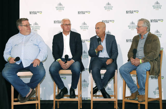 From left, Everfast trainer Dale Romans, Intrepid Heart and Spinoff trainer Todd Pletcher, War of Will trainer Mark Casse and Tacitis trainer Bill Mott answer questions during a draw ceremony for the 2019 Belmont Stakes race, Tuesday, June 4, 2019, in New York. (AP Photo/Kathy Willens)