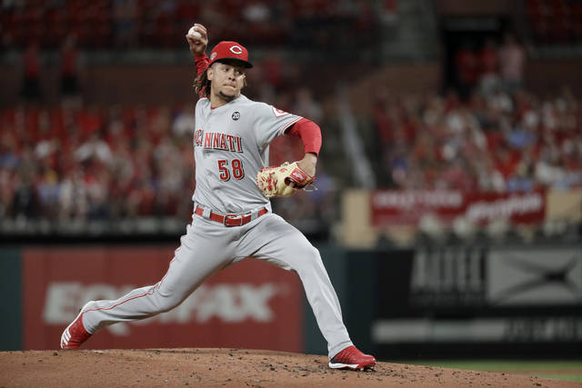Cincinnati Reds starting pitcher Luis Castillo throws during the first inning of the team's baseball game against the St. Louis Cardinals on Tuesday, June 4, 2019, in St. Louis. (AP Photo/Jeff Roberson)