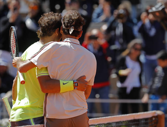 Spain's Rafael Nadal, right, is congratulated by Switzerland's Roger Federer after winning their semifinal match of the French Open tennis tournament at the Roland Garros stadium in Paris, Friday, June 7, 2019. (AP Photo/Michel Euler)