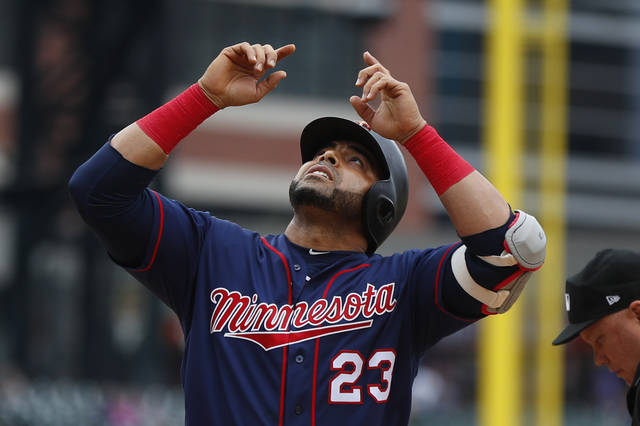 Minnesota Twins' Nelson Cruz celebrates his two-run home run against the Detroit Tigers in the first inning of a baseball game in Detroit, Sunday, June 9, 2019. (AP Photo/Paul Sancya)