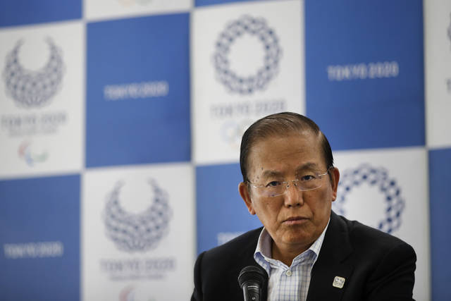 Toshiro Muto, CEO of the 2020 Tokyo Olympics organizing committee, listens to questions from the media during a news conference Tuesday, June 11, 2019, in Tokyo. Cannabis has been legalized in some parts of the world. But the chief executive of next year's Tokyo Olympic reminded potential visitors to the games substances is against the law in Japan.(AP Photo/Jae C. Hong)