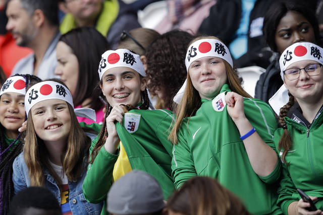 Young fans wearing Japanese flag hair ribbons sit on the stand prior the start of the Women's World Cup Group D soccer match between Argentina and Japan at the Parc des Princes in Paris, Monday, June 10, 2019. (AP Photo/Alessandra Tarantino)