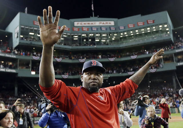 FILE - In this Oct. 10, 2016, file photo, Boston Red Sox's David Ortiz waves from the field at Fenway Park after Game 3 of baseball's American League Division Series against the Cleveland Indians in Boston. Ortiz returned to Boston for medical care after being shot in a bar Sunday, June 9, 2019, in his native Dominican Republic. (AP Photo/Charles Krupa, File)