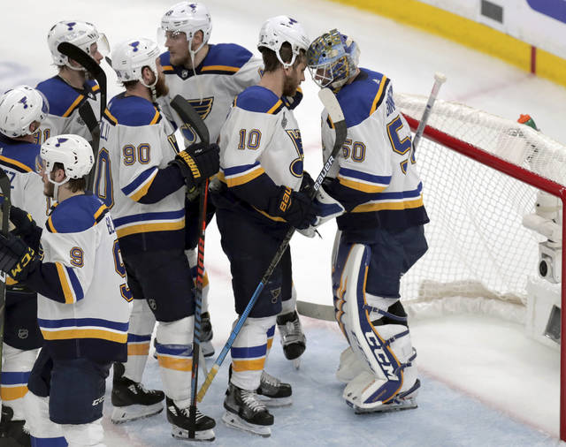 St. Louis Blues teammates congratulate goaltender Jordan Binnington, right, after defeating the Boston Bruins in Game 5 of the NHL hockey Stanley Cup Final, Thursday, June 6, 2019, in Boston. (AP Photo/Charles Krupa)