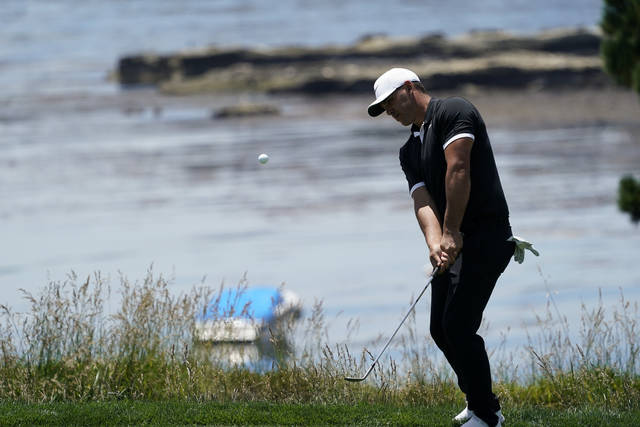 Brooks Koepka hits on the fifth hole during a practice round for the U.S. Open Championship golf tournament Monday, June 10, 2019, in Pebble Beach, Calif. (AP Photo/David J. Phillip)