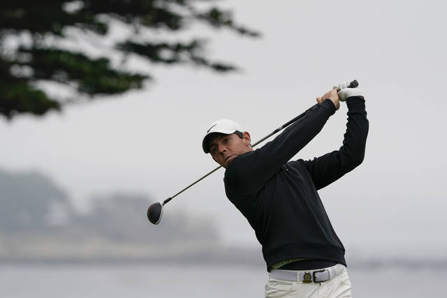 Rory McIlroy, of Northern Ireland, watches his tee shot on the 11th hole during a practice round for the U.S. Open Championship golf tournament Wednesday, June 12, 2019, in Pebble Beach, Calif. (AP Photo/David J. Phillip)