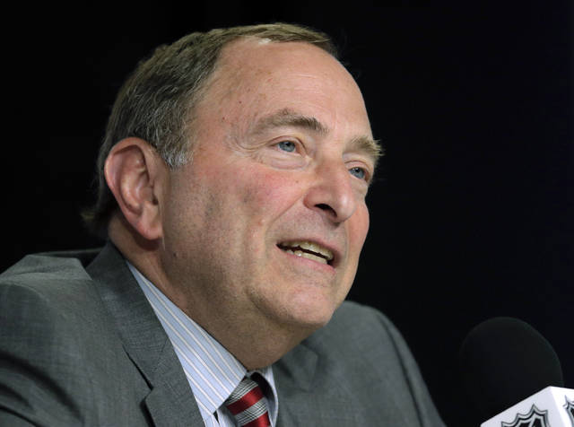 FILE - In this June 6, 2019, file photo, NHL Commissioner Gary Bettman speaks during a news conference before Game 5 of the NHL hockey Stanley Cup Final between the St. Louis Blues and the Boston Bruins in Boston. Under the terms of the collective bargaining agreement, NHL owners and players divide hockey-related revenue 50/50, and if player salaries exceed that split a certain percentage is withheld in escrow to make it even. The Chicago Blackhawks captain Jonathan Toews and fellow players have lost upwards of 10% of their pay to escrow over the past seven seasons, which is why 25 of 31 NHL Players' Association representatives surveyed by The Associated Press and Canadian Press named escrow as the biggest bargaining issue with September deadlines looming to terminate the current CBA effective the fall of 2020. (AP Photo/Charles Krupa, File)