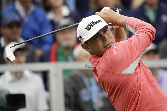 Gary Woodland watches his tee shot on the first hole during the final round of the U.S. Open Championship golf tournament Sunday, June 16, 2019, in Pebble Beach, Calif. (AP Photo/Marcio Jose Sanchez)