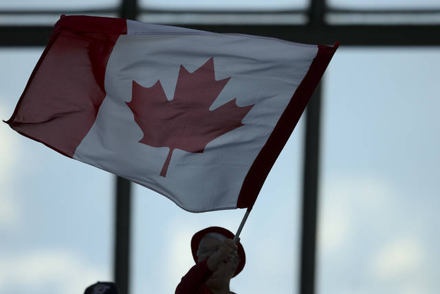 Canada fans wait for the start of the Women's World Cup Group E soccer match between Canada and New Zealand in Grenoble, France, Saturday, June 15, 2019. (AP Photo/Francisco Seco)