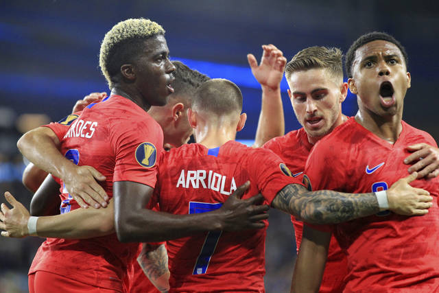 United States' Paul Arriola (7) celebrates with teammates Gyasi Zardes, left, Tyler Boyd, center, and Weston Mckennie, right, after scoring a goal on Guyana during the first half of a CONCACAF Gold Cup soccer match Tuesday, June 18, 2019, in St. Paul, Minn. (AP Photo/Andy Clayton-King)