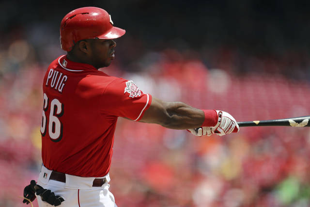 Cincinnati Reds' Yasiel Puig hits a solo home run in the second inning of a baseball game against the Houston Astros, Wednesday, June 19, 2019, in Cincinnati. (AP Photo/Aaron Doster)