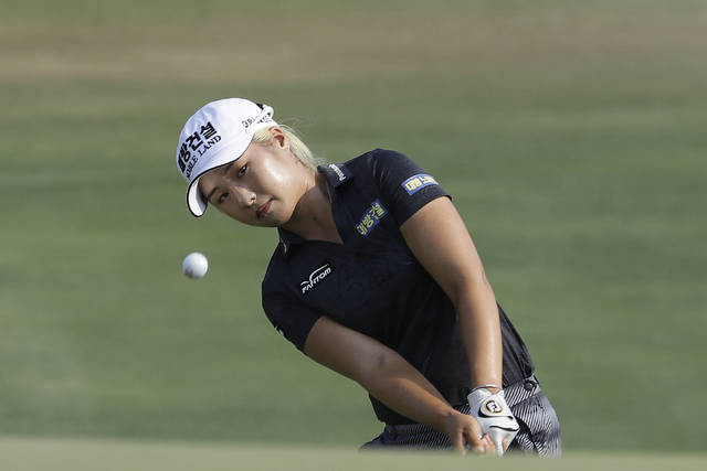 FILE - In this June 2, 2019, file photo, Jeongeun Lee6, of South Korea, chips to the 16th green during the final round of the U.S. Women's Open golf tournament, in Charleston, S.C. Hazeltine has a recent history of shockers, whether it was Rich Beem or Y.E. Yang winning the PGA Championship or the Americans winning the Ryder Cup. Now it hosts the Women's PGA Championship, a major that is rising to the top with the courses it plays. Women's Open champion Jeongeun Lee6 will be part of a strong field that features 99 or the 100 on the LPGA money list.  (AP Photo/Steve Helber, File)