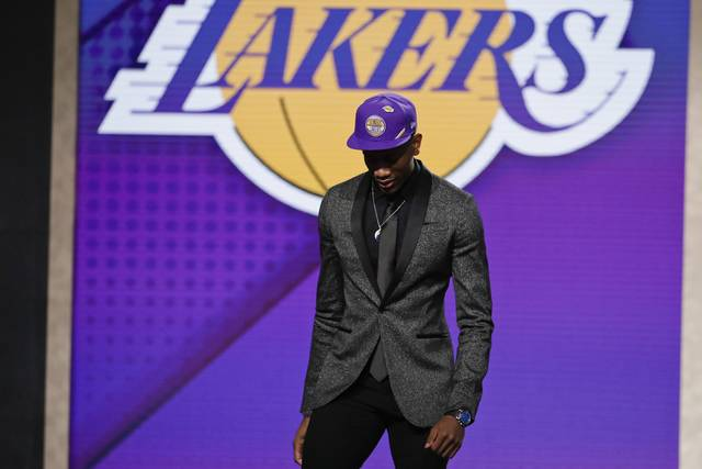De'Andre Hunter, of Virginia, leaves the stage after being selected with the fourth pick overall by the Los Angeles Lakers during the NBA basketball draft Thursday, June 20, 2019, in New York. (AP Photo/Julio Cortez)