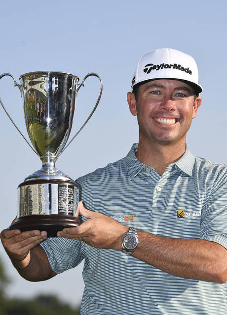 Chez Reavie, winner of the Travelers Championship golf tournament, poses with the trophy, Sunday, June 23, 2019, in Cromwell, Conn. (AP Photo/Jessica Hill)