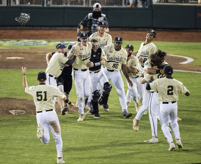 Vanderbilt celebrates an 8-2 win over Michigan during the deciding game of the NCAA College World Series baseball finals Wednesday, June 26, 2019, in Omaha, Neb. (Chris Machian/Omaha World-Herald via AP)