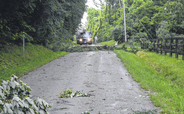 Chester Township emergency crews were among those working on Oglesbee Road, which had to be closed due to fallen limbs and toppled power lines.