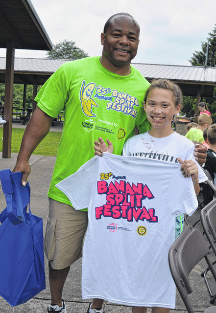 Lilly Carlier, right, is the winner of the 2019 Banana Split Eating Contest in the youngest age bracket. Wilmington Parks & Recreation Director Jermaine Isaac, left, congratulates her. Lilly, you can wear your new Banana Split Festival T-shirt with pride!
