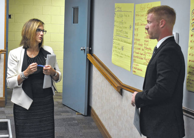 Wilmington City Schools Superintendent Mindy McCarty-Stewart chats with Ryan Schlater, the new elementary school assistant principal, at Friday morning's Wilmington City Schools board meeting.