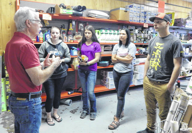 Habitat volunteer Dan Kennelly discusses the Restore operation with students , from left, Skylar Brown, Chyenne Fawcett, Gracie Platt and Matthew Mangold.
