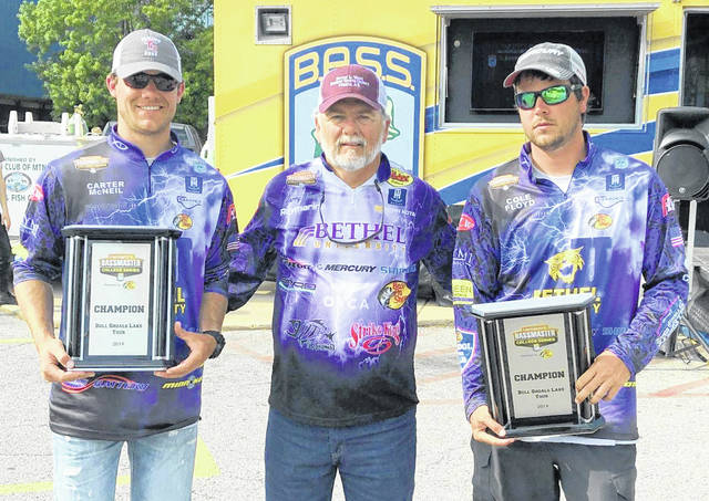 Carter McNeil (left) and Cole Floyd (right) with Bethel fishing coach Garry Mason.