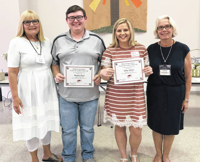 From left are Joyce Kelly, Chairman of the Scholarship Selection Committee; scholarship winners Clayton Boyd and Sally Shaffer; and Lorry Swindler President.