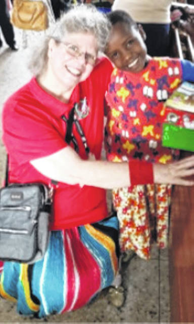 Barbara Lanctot of Wilmington with one of her new young friends in Tanzania.