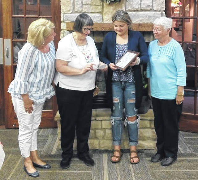 The Clinton County Women's Club awarded four scholarships at its meeting Wednesday evening. Shown from left are Patti Cook, Mary Camp, Carson Smith and Thelma Ledford. The other scholarship recipients were Alexus Andrew, Emily Ireland and Emily Singleton.