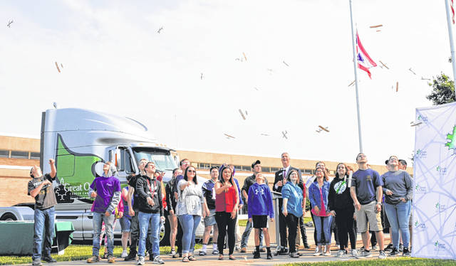 "Gliders — albeit miniature ones — once again fill the sky at the former air field for gliders utilized in World War II. The activity Tuesday morning was in connection with the ""launch"" of a major construction project at Laurel Oaks Career Campus."