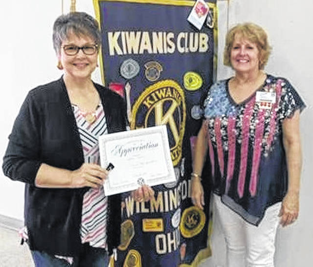 The Wilmington Kiwanis Club met Thursday and Robyn Morris, owner of Kairos Coffee, spoke about the starting of the business and upcoming events and visions of the business in the community. Shown, Morris is presented with a a certificate and pen by Program Chair Kiwanian Robyn Hinman. Also, Kiwanians discussed the upcoming soccer tournament — the 11th Annual Kiwanis Quaker Cup on Saturday, July 6 starting at 8 a.m. that will be held at Wilmington College and at Wilmington High School, where high school soccer teams will be competing.