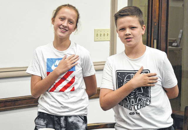 With school out for the summer, Clinton County Commissioner Mike McCarty's children attended Monday morning's business session of the Board of Clinton County Commissioners. Clinton County Commissioner Kerry R. Steed asked the two young citizens to lead the Pledge of Allegiance to start off the meeting.