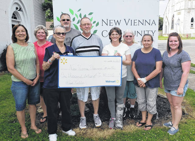 The New Vienna Planning committee — representing the New Vienna Community Center — accepted a $1,000 grant from Wal-Mart for continued community outreach projects. Wal-Mart recognizes the need to support local efforts that benefit communities and offers yearly grants to those that qualify. Pictured is Wal-Mart representative Ann Norman presenting the check to Carla Beers (NVPC member). In back from left are committee members Linda Ruble, Alice Hatter, Russ Hatter, Chuck Morris, Terri Willett, Susan Boldman and Sarah Ford. More information and monthly activities can be found at http://nvcommunitycenter.com.