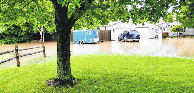 This flooded yard in Sabina over the weekend tells the story of what kind of weekend, and what kind of spring, it has been.