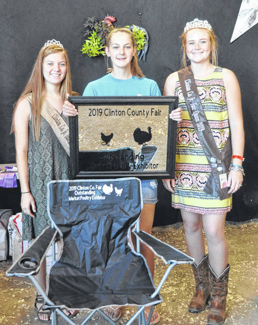 Outstanding Market Poultry Exhibitor is Ava Hester, shown with Poultry Queen Darcie Zeckser and Fair Queen Myah Jones.