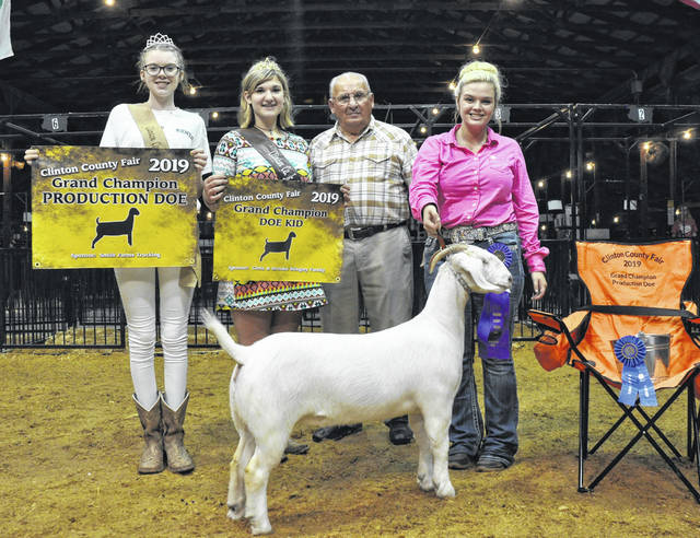 Grand Champion Meat Production Doe; from left are Queen Mackenzie Osborne, Fair Princess Paris Eades, Judge Bob Hare, and winner Kyle Price.