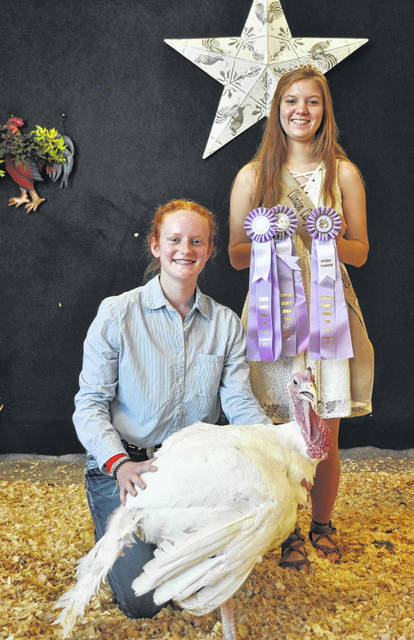 Reserve Champion Market Turkey winner is Josie Jones, with Poultry Queen Darcie Zeckser.