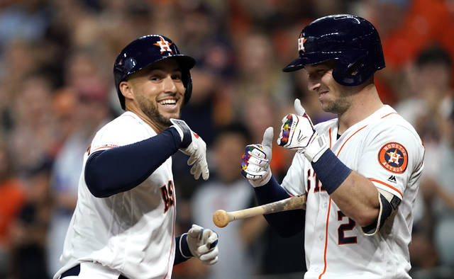 Houston Astros' George Springer, left, celebrates with Alex Bregman (2) after hitting a home run against the Pittsburgh Pirates during the first inning of a baseball game Wednesday, June 26, 2019, in Houston. (AP Photo/David J. Phillip)