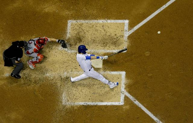 Milwaukee Brewers' Christian Yelich hits a two-run home run during the fifth inning of a baseball game against the Cincinnati Reds Friday, June 21, 2019, in Milwaukee. (AP Photo/Morry Gash)