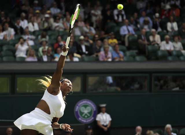 United States' Serena Williams serves to Italy's Giulia Gatto-Monticone in a Women's singles match during day two of the Wimbledon Tennis Championships in London, Tuesday, July 2, 2019. (AP Photo/Ben Curtis)