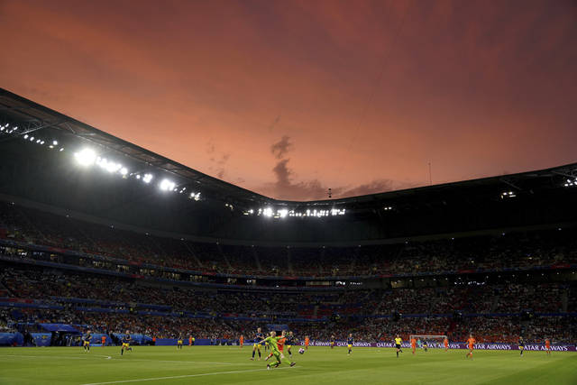 Sweden goalkeeper Hedvig Lindahl kicks a ball as the sun sets during the Women's World Cup semifinal soccer match between the Netherlands and Sweden at the Stade de Lyon outside Lyon, France, Wednesday, July 3, 2019. (AP Photo/Laurent Cipriani)