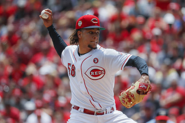 Cincinnati Reds starting pitcher Luis Castillo throws in the first inning of a baseball game against the Milwaukee Brewers, Thursday, July 4, 2019, in Cincinnati. (AP Photo/John Minchillo)