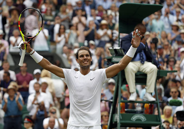 Spain's Rafael Nadal celebrates after beating Portugal's Joao Sousa in a Men's singles match during day seven of the Wimbledon Tennis Championships in London, Monday, July 8, 2019. (AP Photo/Alastair Grant)
