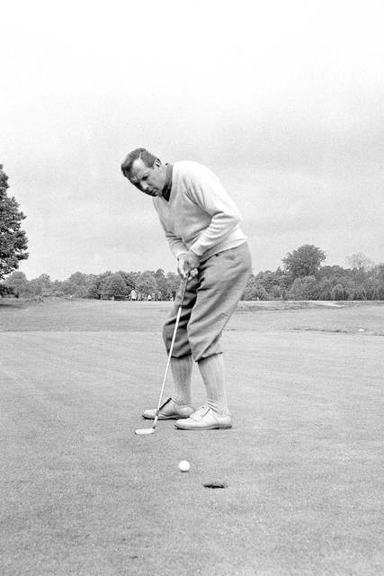 FILE - In this June 9, 1960, file photo, Max Faulkner putts at Wentworth Club in Virginia Water, England. The British Open returns to Royal Portrush on July 18-21, 2019, for the first time since 1951, the only other time golf's oldest championship as been held outside Scotland or England. Max Faulkner won his only major on a rainy final day in Northern Ireland. (AP Photo/File)