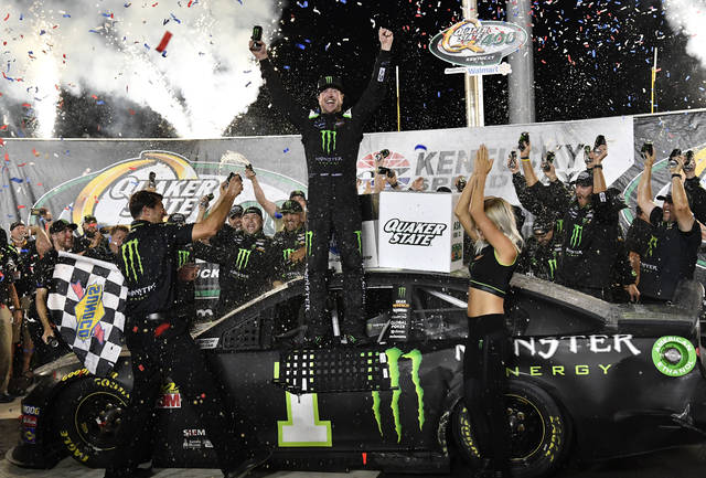 Kurt Busch celebrates his win in the NASCAR Cup Series auto race at Kentucky Speedway in Sparta, Ky., Saturday, July 13, 2019. (AP Photo/Timothy D. Easley)